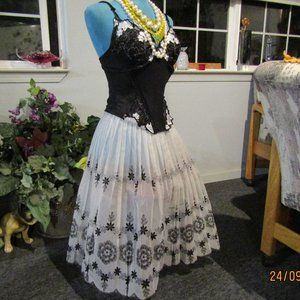 black corset  36 and pleated sheer skirt  size 10